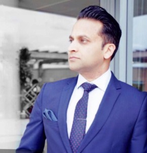 Tarak Nath Gorai Bio Headshot in a cool blue suit