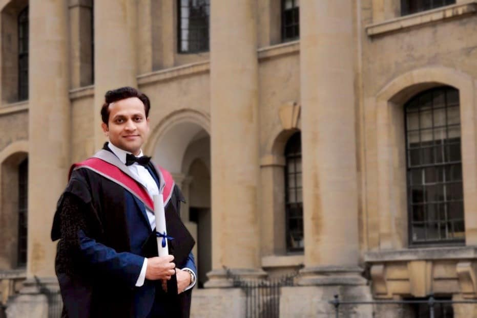 Tarak Nath Gorai standing with his graduation degree in from of Oxford University on Graduation Day, Oxford MBA